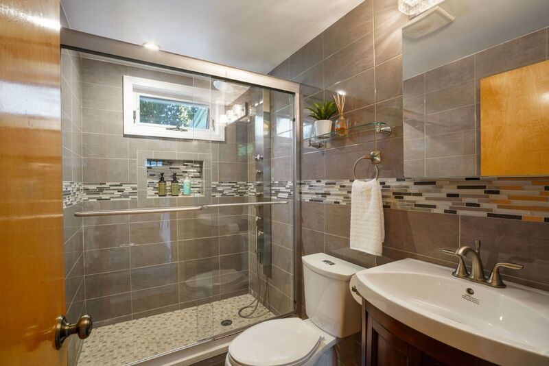 1st floor bathroom with large tiled shower.